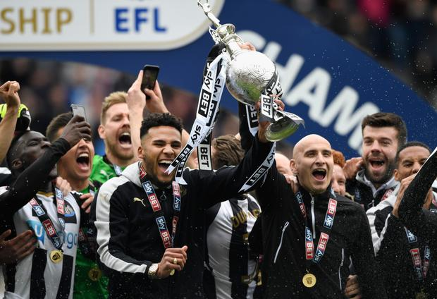 Newcastle United players celebrate winning the Championship last season Photo: Getty