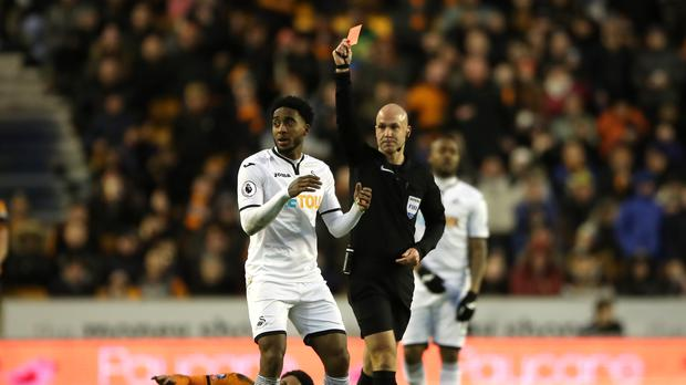 Swansea midfielder Leroy Fer, left, was shown a red card during the FA Cup third-round tie at Wolves