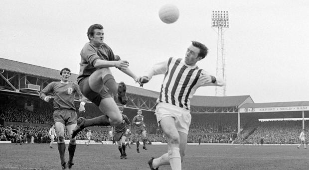 Liverpool goalkeeper Tommy Lawrence, left, rushes out to snuff out an attack