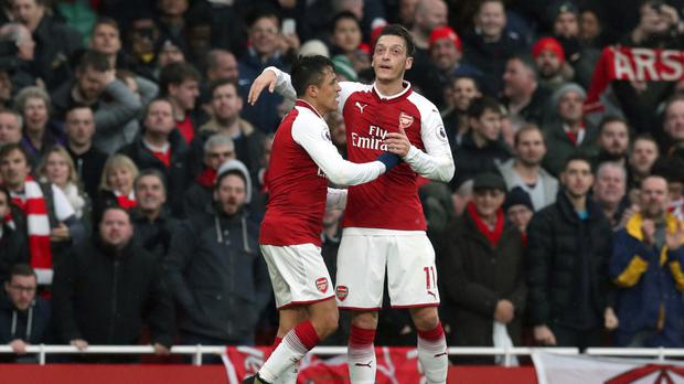 Alexis Sanchez, left, looks set to leave but will Mesut Ozil?