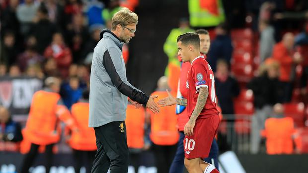 Liverpool manager Jurgen Klopp, left, admits he had to sell Philippe Coutinho