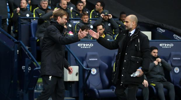 Liverpool manager Jurgen Klopp, left, wants to correct September's anomaly against Manchester City