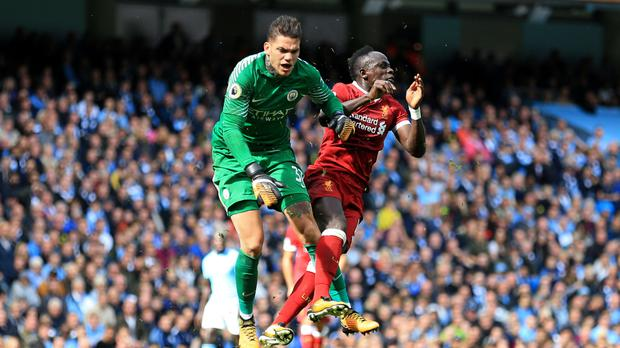 Sadio Mane (right) collides with Manchester City goalkeeper Ederson earlier this season