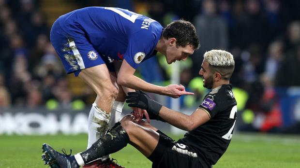 Chelsea's Andreas Christensen (left) has words with Leicester City's Riyad Mahrez