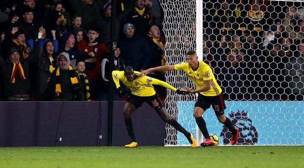 Watford's Abdoulaye Doucoure, left, celebrates scoring his side's equaliser against Southampton