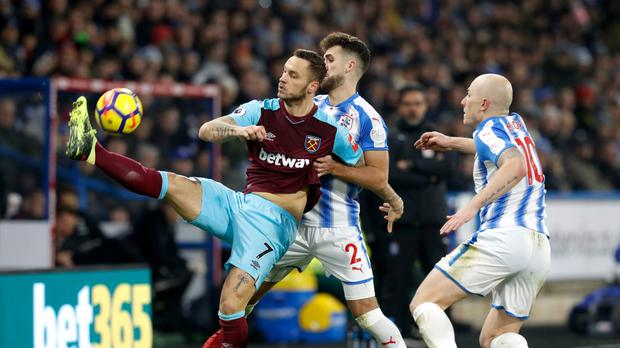 Marko Arnautovic, pictured left, was Huddersfield's tormentor in chief