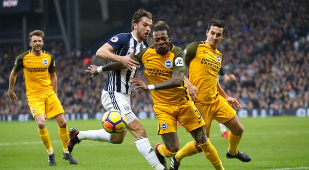 Brighton have given their backing to Gaetan Bong (front) after the defender accused Jay Rodriguez of racially abusing him