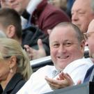 Newcastle owner Mike Ashley (centre) and managing director Lee Charnley (right) in the stands at St James' Park (Owen Humphreys/PA)