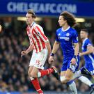 Stoke striker Peter Crouch playing against Chelsea