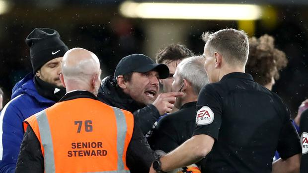Chelsea head coach Antonio Conte speaks to referee Graham Scott during the FA Cup clash with Norwich