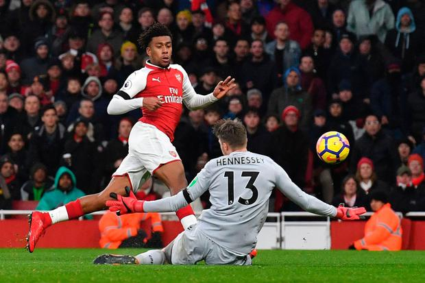 Striker Alex Iwobi shoots by Crystal Palace's goalkeeper Wayne Hennessey to score Arsenal's second goal at the Emirates Stadium yesterday. Photo: Ben Stansall