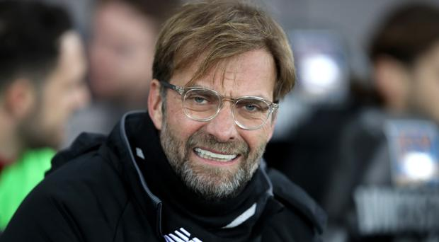 Jurgen Klopp apologises after altercation with fan in Liverpool's defeat at Swansea
