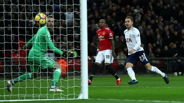 Christian Eriksen, right, scores against Manchester United