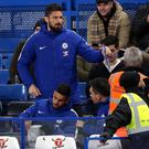 Olivier Giroud watched from the Stamford Bridge stands on Wednesday
