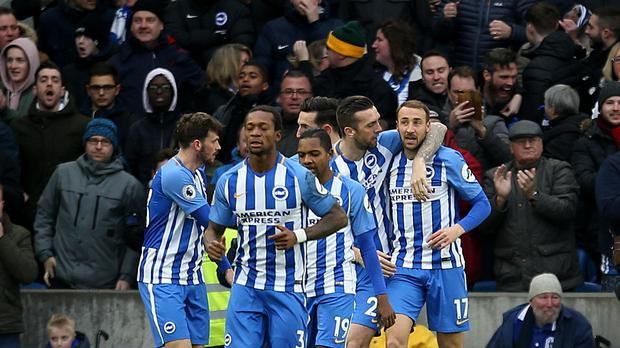 Brighton's Glenn Murray (right) celebrates scoring his side's first goal of the game during the Premier League match at the AMEX Stadium, Brighton (Steven Paston/PA).