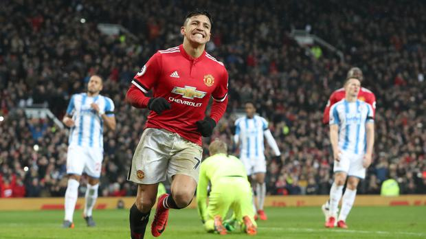 Alexis Sanchez celebrates scoring his first Manchester United goal