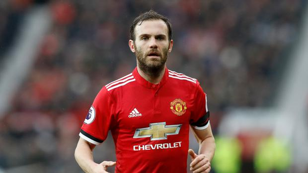 Juan Mata helped Manchester United to victory against Huddersfield