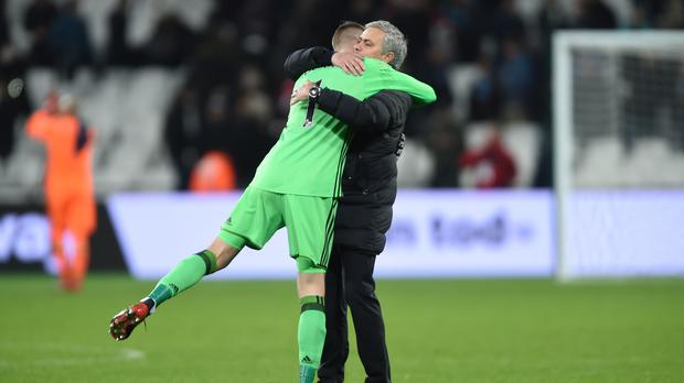 Jose Mourinho, right, is determined David De Gea will not be leaving Old Trafford