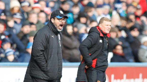 David Wagner, left, came out on top against Eddie Howe's Bournemouth