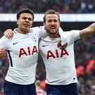 Harry Kane celebrates his second-half goal against Arsenal