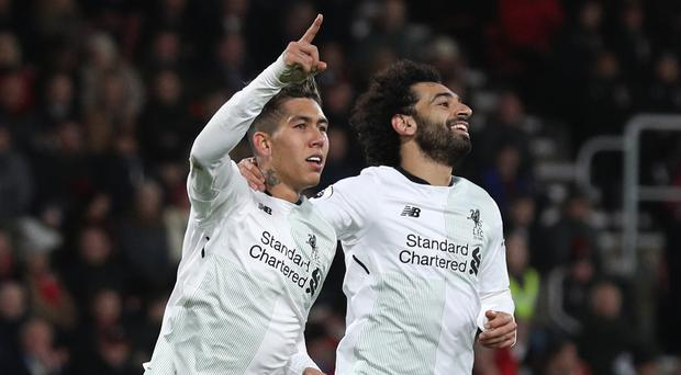 Roberto Firmino, left, and Mohamed Salah will determine Liverpool's progress this season, according to Andrew Robertson