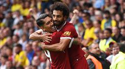 Roberto Firmino (left) and Mohamed Salah (right) have scored 51 goals between them so far this season