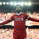 Liverpool's Mohamed Salah celebrates scoring his side's second goal in the win over West Ham (Peter Byrne/PA)