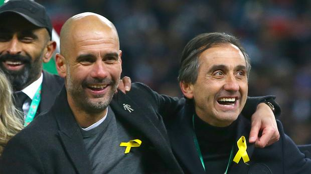 Pep Guardiola (left) has insisted is yellow ribbon protest is not political but the FA disagree