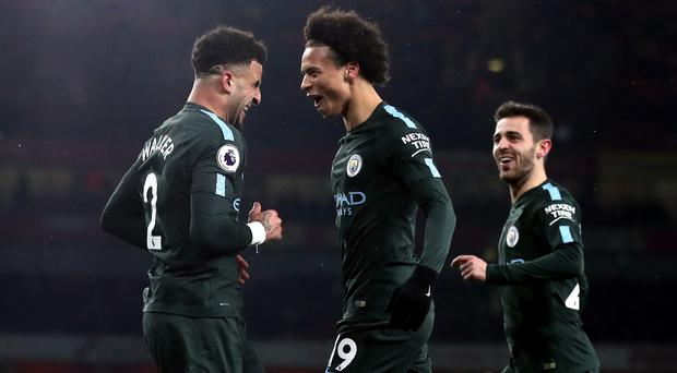 Leroy Sane, centre, celebrates with fellow scorer Bernardo Silva, right, and Kyle Walker
