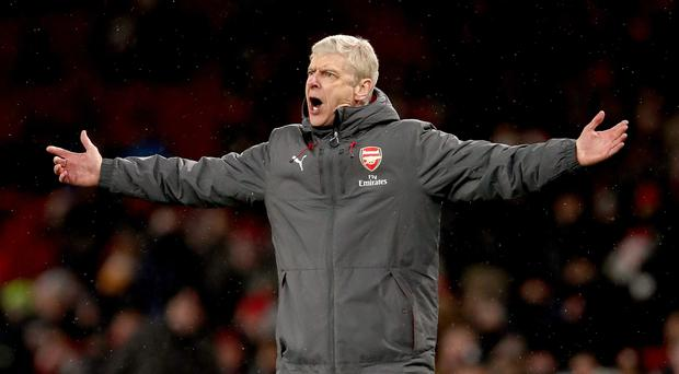 Arsene Wenger is under heavy pressure ahead of Arsenal's clash with Brighton