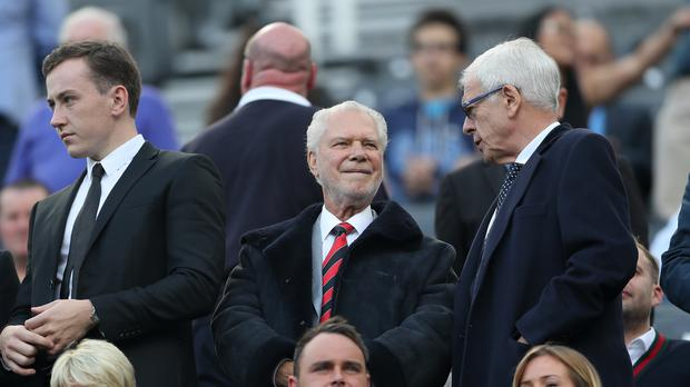West Ham's co-owner David Gold, centre, was involved in an angry exchange with the club's fans outside the Liberty Stadium