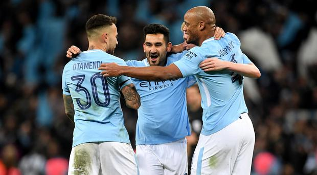 Ilkay Gundogan (centre) and Manchester City are powering towards the title