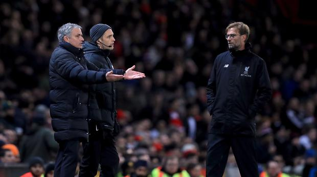 Jose Mourinho, left, and Jurgen Klopp renew hostilities on Saturday