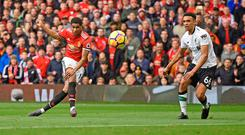 Manchester United's Marcus Rashford scores his first goal against Liverpool as Trent Alexander-Arnold looks on at Old Trafford yesterday. Photo: Oli Scarff
