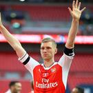 Arsenal defender Per Mertesacker has opened up about the burden of playing under pressure