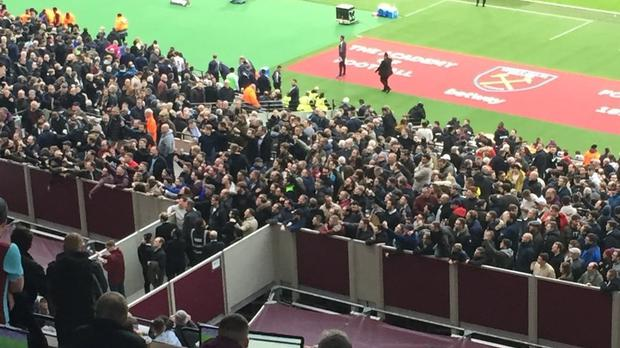 Fans gather in front the directors box in order to vent their frustrations
