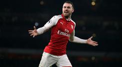 Chelsea are said to be keeping tabs on Arsenal's 27-year-old midfielder (John Walton/Empics/PA)