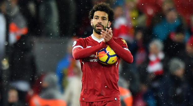 Mohamed Salah scored his first Liverpool hat-trick with four goals against Watford .
