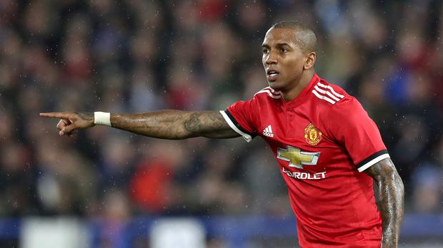 Ashley Young is staying at Old Trafford for another season