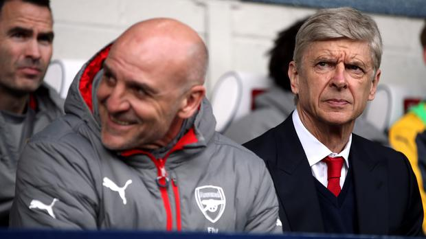 Steve Bould, left, has backed under-fire Arsene Wenger to succeed with Arsenal
