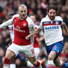 Arsenal's Jack Wilshere, left, and Stoke's Joe Allen battle for the ball