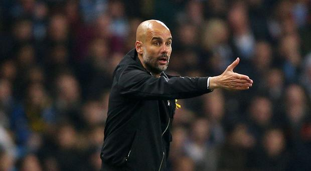 Manchester City manager Pep Guardiola insists the title race is not yet over