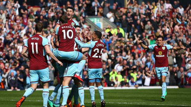 Burnley's players celebrate Kevin Long's goal, which proved to be the winner against Leicester