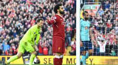 Mohamed Salah stands in front of The Kop after scoring again (Anthony Devlin/PA)