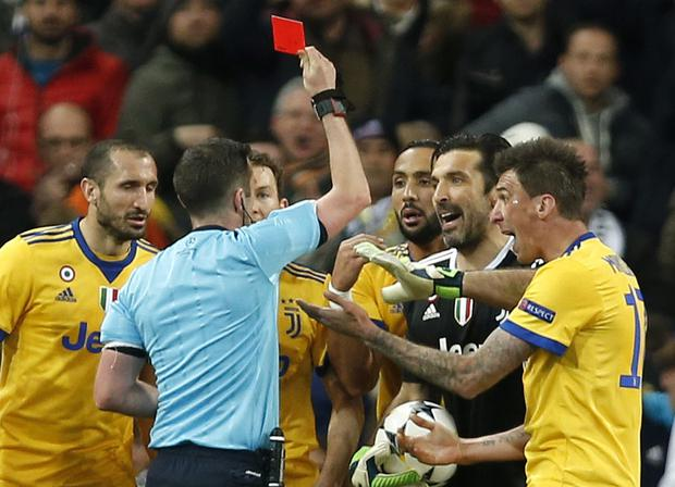Michael Oliver dismisses Gianlugi Buffon during the Champions League quarter-final second leg at the Bernabeu
