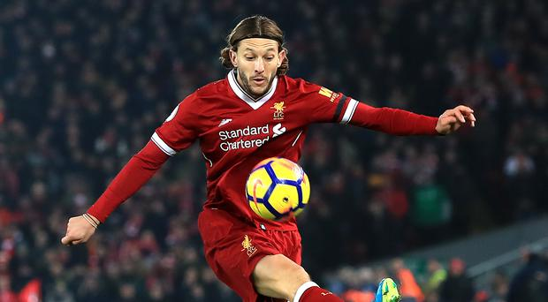 Liverpool midfielder Adam Lallana has travelled to South Africa for treatment on a hamstring injury.