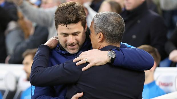 Mauricio Pochettino, left, saw Tottenham held by Chris Hughton's Brighton