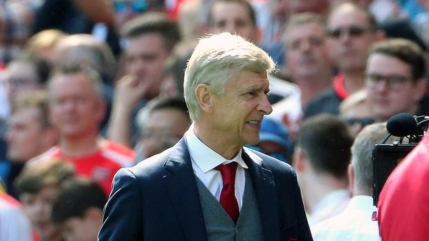 Arsene Wenger watched Arsenal win 4-1 on Sunday