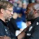 West Brom caretaker manager Darren Moore, right, saw his side draw with Jurgen Klopp's Liverpool