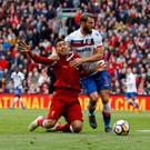 Liverpool's Roberto Firmino goes down under a challenge from Stoke City's Erik Pieters. Photo: Reuters